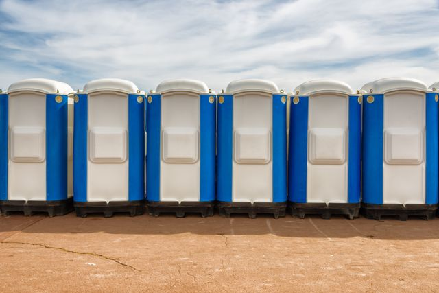 row of portable toilets lined up