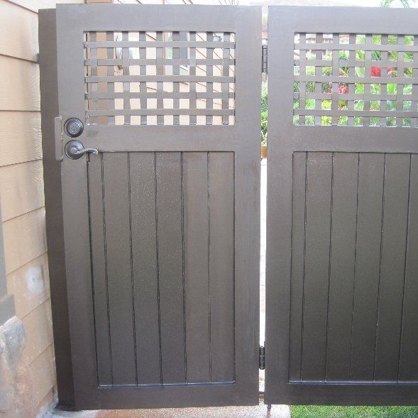 Custom gate and fencing for a Makakilo residence.