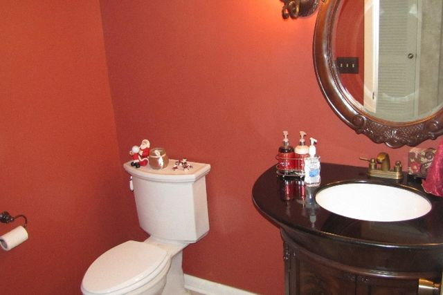 bathroom with red walls and new sink