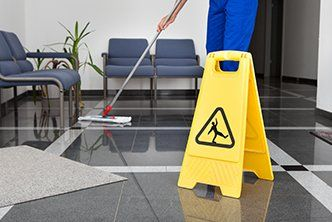 Staff member mopping the floor
