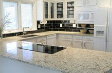 White kitchen with marble worktops