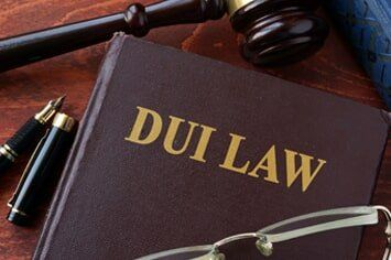 DUI Attorney � Gavel and Pen with DUI Law Book in Bakersfield, CA