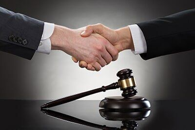 Lawyer �  Handshake with Gavel in Bakersfield, CA