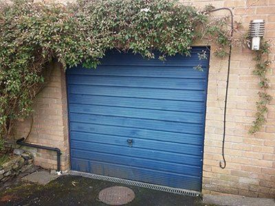A shabby old sectional garage door