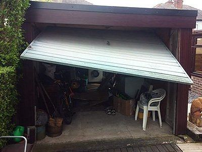 A broken up and over garage door
