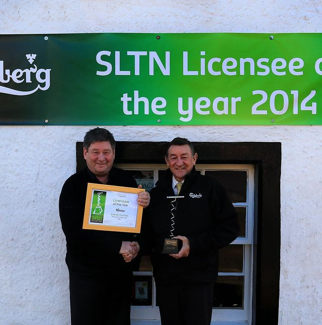 Staff showing award for Licensee of the year