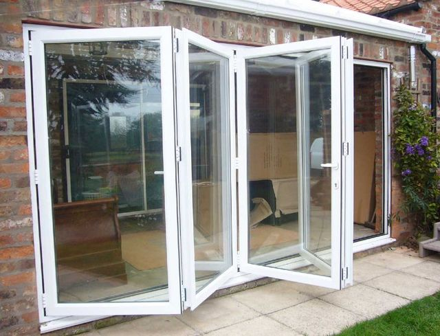 Doors u0026 Bi-Folds · Tiled Conservatory Roofs & Right Style Double Glazing u0026 Conservatory Experts pezcame.com