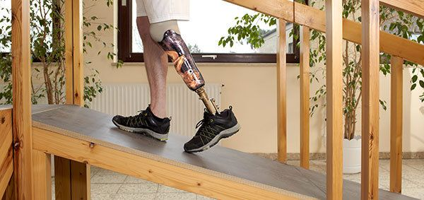man with prosthetic leg walking on a slope in Honolulu