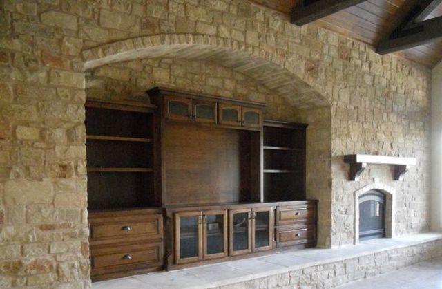custom entertainment center inside a stone wall