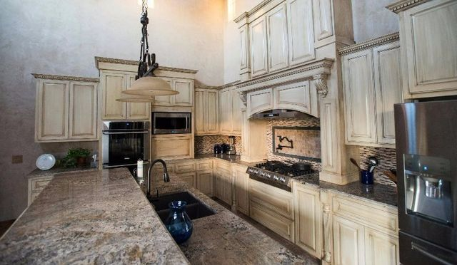Huge kitchen with custom cabinets designed and installed by JB Murphy Co., - custom kitchen cabinet makers