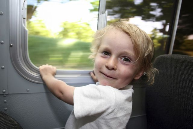 Boy enjoys bus ride