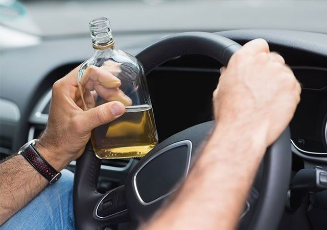 Man Holding Alcohol While Driving Law Office In Independence MO