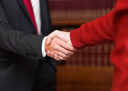 Handshake between a client and lawyer representing them