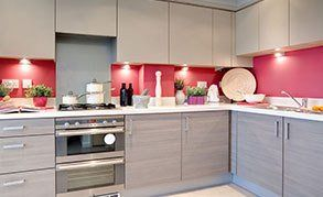 A contemporary kitchen with red walls