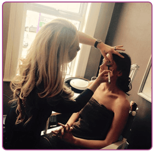 Make-up being applied to female model