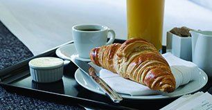 croissant, tea and juice