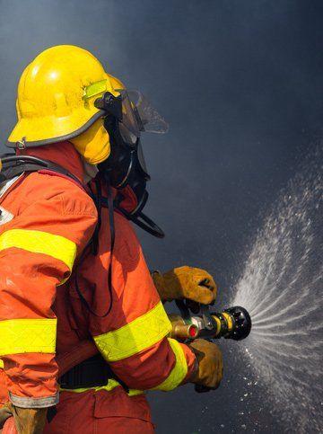 delta fire firemen in full gear in training