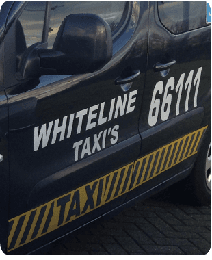 Close up of the side of a black taxi