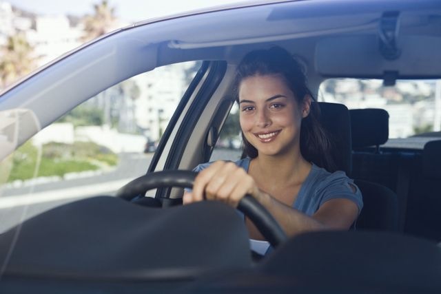 Satisfied woman with windscreen repair in Christchurch