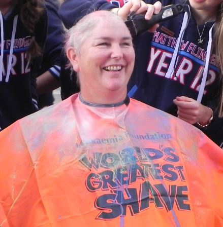 Women getting her hair shaved