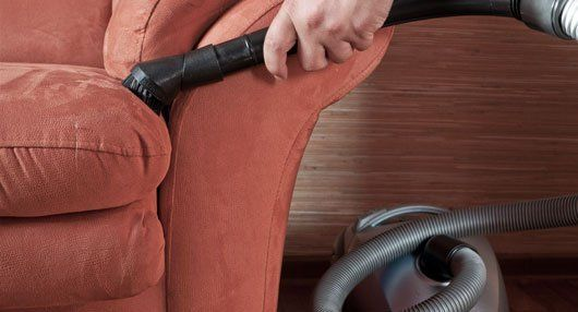 vacuum cleaner used to clean the couch