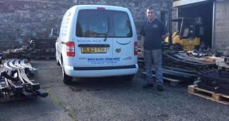 One of the team with the company van