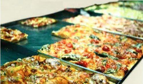 tranci di pizze al taglio di vari gusti