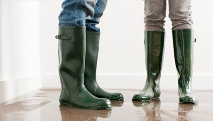 Two men wearing rubber boots