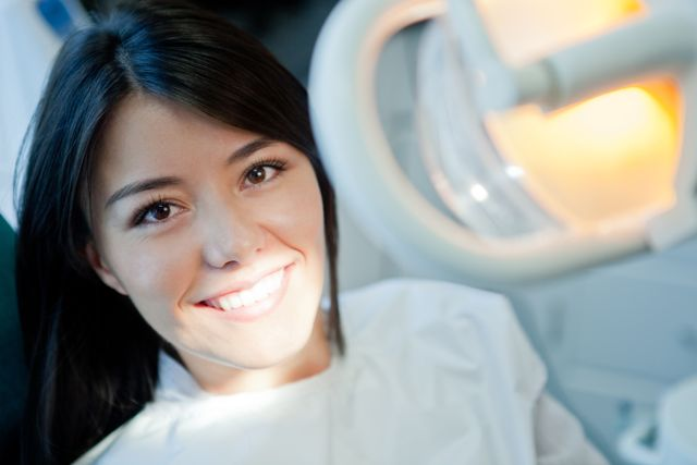 Woman about to have her teeth whitened