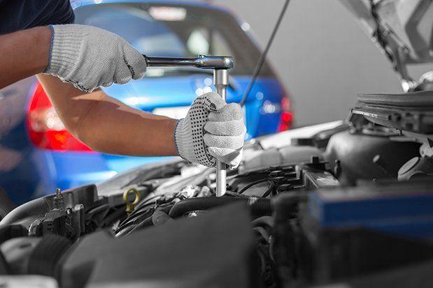 Mechanic working in auto repair garage