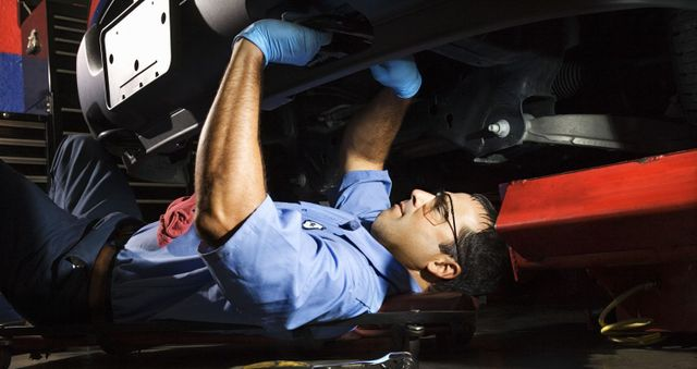 A car being worked on in a Holden service centre