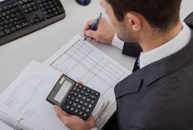 Man calculating accounts