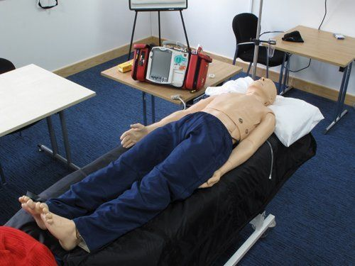 medical dummy on a hospital bed
