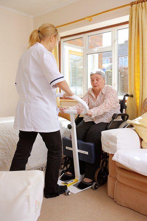 elderly women being cared for