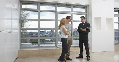 Agent showing the new apartment to couple