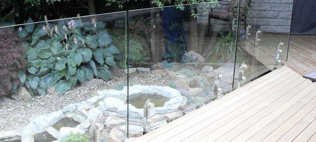 glass fence around garden