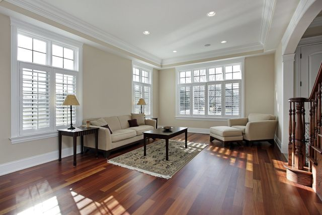 white window shutters in a large living room
