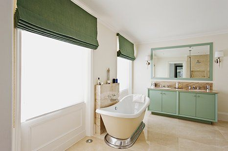 green roman blinds in a bathroom