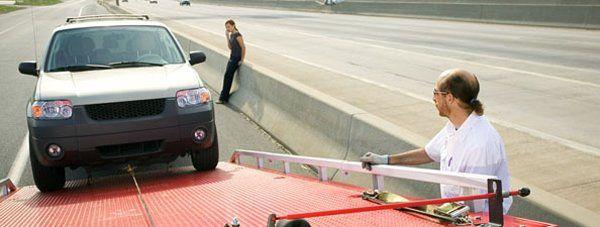 Woman calling for road automotive towing in Dalton, GA