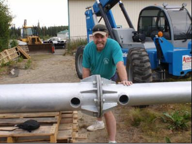 Man working on a solar energy product in Soldotna, AK