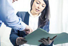 A woman reading through a legal document