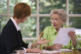 An older lady speaking with her solicitor