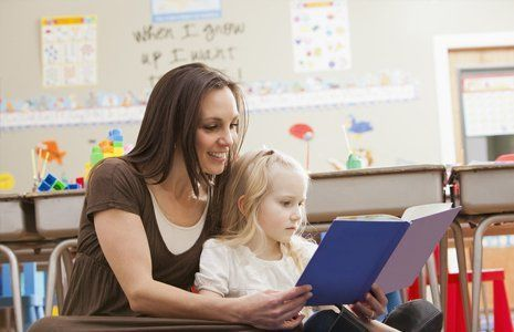 child learning with teacher