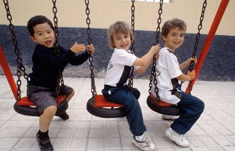 kids playing on the swing