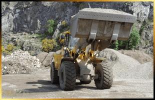 Tipper moving some aggregates around a quarry