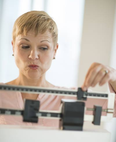 woman loses weight with hA2cg Diet Treatments