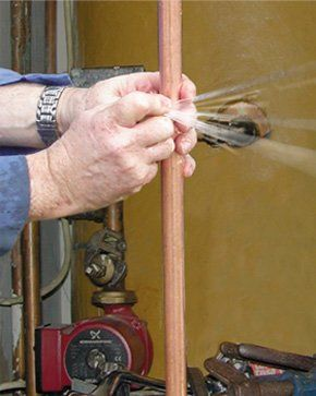 Water is bursting out of a copper pipe