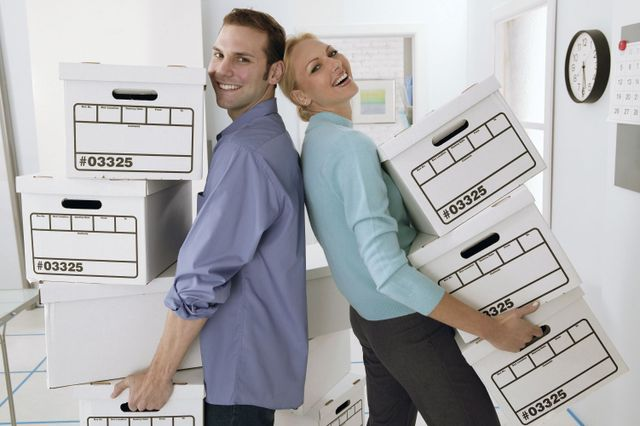 A couple with storage boxes