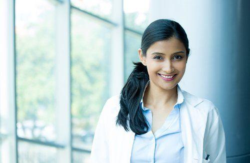 Smiling female dentist in Vancouver