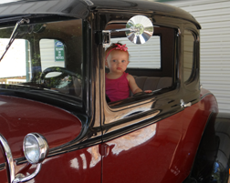 Cute baby girl in a car